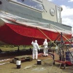 Restoration of the hull - combination of spraying and manual lamination