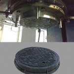 A DN600 manhole cover being pressed