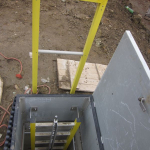 Composite ladder with top handles