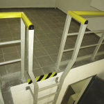 Wide top of a composite wall-mounted ladder