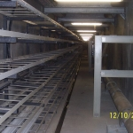 Utility tunnel in downtown Ostrava - FRP pylon with support beds, cable runs and carriers of pipelines