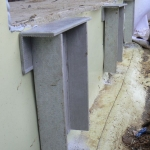 Composite anchors for windows and doors in passive houses - reinforced composite L profiles