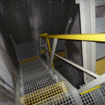 Construction of a composite staircase with railings