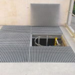 Moulded gratings covering a hole with composite ladder with safety cage