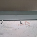 Composite drainage trough made by manual lamination